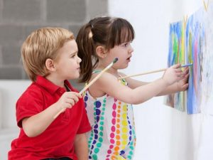 Two children painting